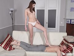 Slender long haired brunette Alita Angel gives a footjob and rides detect