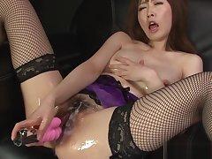 Asian slut strips sexy lingerie during a catch slippery masturba