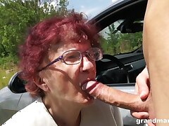 Nerdy mature redhead is so expropriate roughly give a so so blowjob outdoors